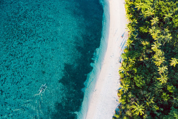 Top down view of tropical landscape with turquoise water and white sand