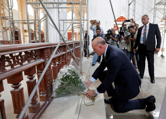 Australian Minister of Home Affairs Peter Dutton places a flower wreath at the St.Sebastian's church in Negombo
