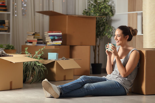 Happy tenant resting drinking coffee moving home