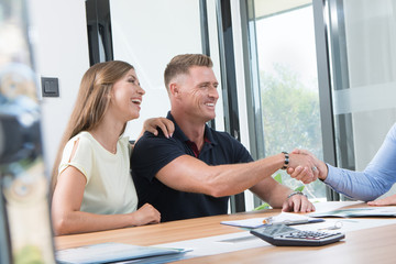 portrait of nice young couple in business office  background