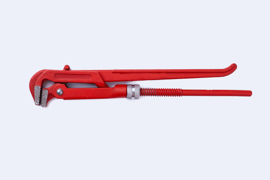 Adjustable red pipe wrench isolated on white background. Wrench with clipping path. Repair concept.