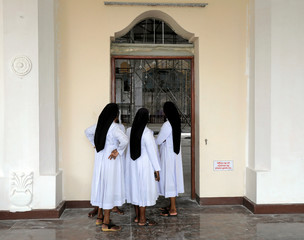 Nuns look inside the St.Sebastian's church, one of the churches attacked in the April 21st Easter Sunday bombings in Negombo