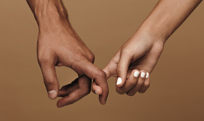 Couple linking index fingers