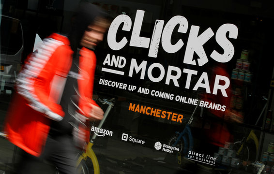A man walks past the Amazon-backed pop up store 'Clicks and Mortar' in Manchester