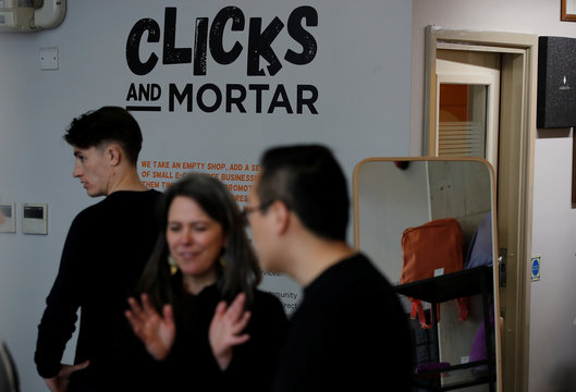 People are seen inside the Amazon-backed pop up store 'Clicks and Mortar' in Manchester