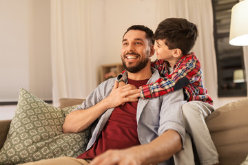 family, childhood, fatherhood, leisure and people concept - portrait of happy smiling father and...