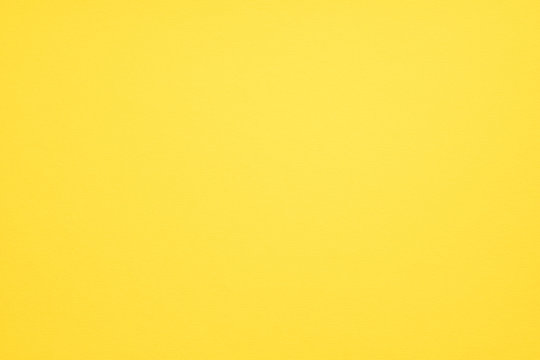 Yellow felt texture abstract art background. Colored fabric fibers surface. Empty space.