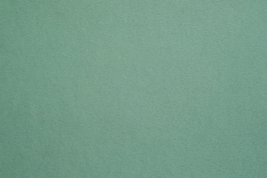 Dark sage green felt texture abstract art background. Colored construction paper surface. Empty space.