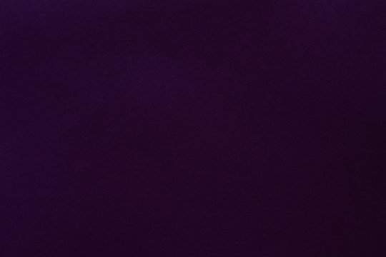 Dark purple felt texture abstract art background. Colored fabric fibers surface. Empty space.