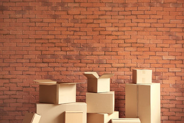Cardboard boxes near brick wall