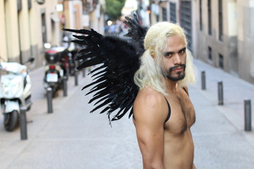 Gorgeous shirtless ethnic man with wings