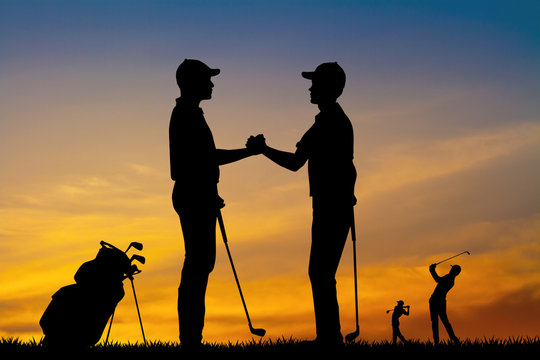 golfers shake hands for victory