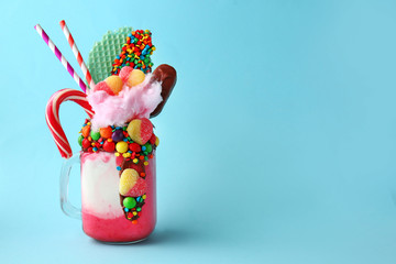 Delicious freak shake on color background