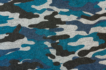 Blue black camouflage fabric texture background