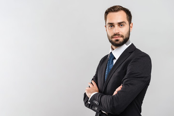Attractive young businessman wearing suit Wall mural