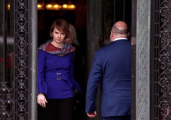 Grigory Lukiyantsev, Ministry of Foreign Affairs of Russia for human rights and Olena Zerkal, Deputy Minister of Foreign Affairs of Ukraine, are seen crossing paths at the International Court of Justice in The Hague