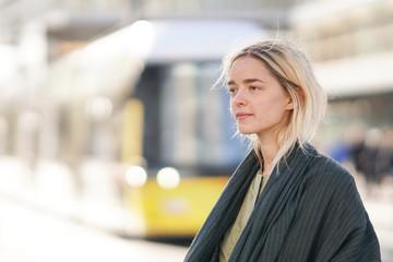 Woman with public transportation in Berlin, Germany