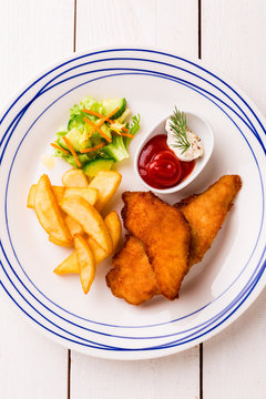 Kid's meal  - fried chicken strips, french fries, salad and ketchup