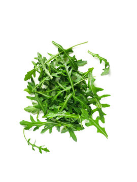 Heap of arugula leaves. Fresh green arugula or rucola leaves isolated on white with clipping path. Top view or flat lay