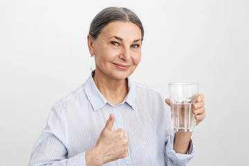 Refreshment, hygiene, health care and beauty concept. Attractive confident elderly European female...