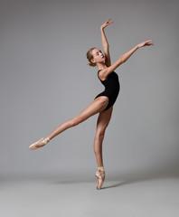 Graceful ballerina posing. Color photo.