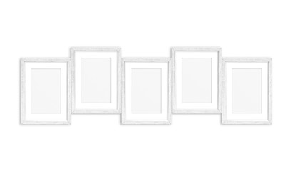 Frames collage, five white painted wooden realistic frameworks isolated on white wall, interior decor mock up