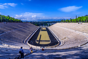 Athens, Attica / Greece - October 29, 2018: The Panathenaic Stadium or Kallimarmaro. It hosted the opening and closing ceremonies of the first modern Olympics in 1896. Sunny day, cloudy blue sky