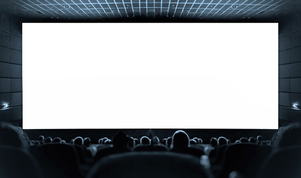 Cinema. White screen in the cinema and the audience watching the movie.