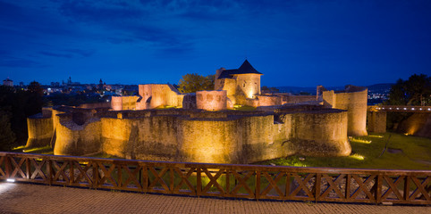 Suceava Fortress (Cetatea Șcheia). 14th century fortress in nighttime. Romania