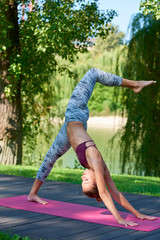 Woman practicing yoga outdoors in the park