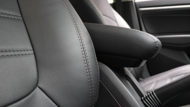 beautiful leather car interior design. faux leather front seats in car. luxury leather seats in the car. Black leather seat covers in the car.