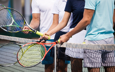 Fototapeta Fit happy poeple playing tennis together. Sport concept obraz