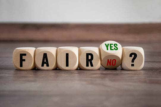 Cubes and dice with fair yes or no on wooden background