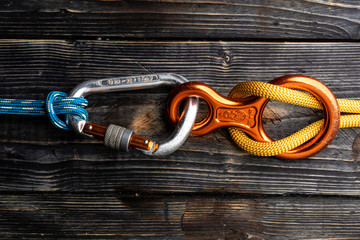 Close up of climbing gear on wooden desk - table top shot