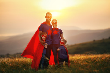 concept of super family, family of superheroes at sunset Wall mural