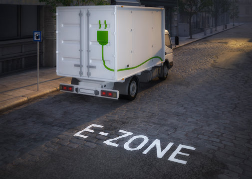 electric truck in electric cars only zone with highrise in the background