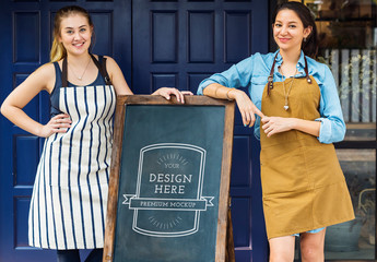 Business Owners Standing with Blackboard Mockup