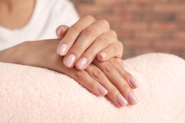 Foto op Canvas Manicure Woman showing neat manicure on towel, closeup. Spa treatment