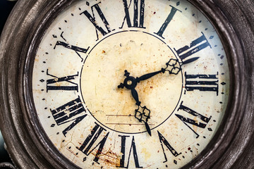 Close up old antique classic clock. Concept of time, history, science, memory, information. Retro style. Vintage background.