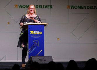 Women Deliver President and CEO Iversen smiles as she steps to the podium during the opening of the Women Deliver 2019 Conference at the Vancouver Convention Centre in Vancouver