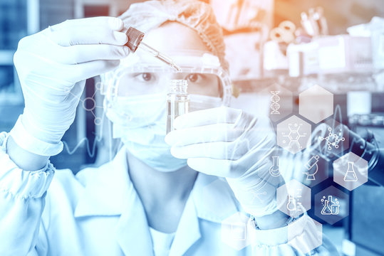 Young woman medical Health care researchers working in life science laboratory. analyzing microscope slides in research laboratory. Medicine concept.