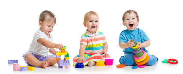 nursery babies play with educational toys, isolated on white
