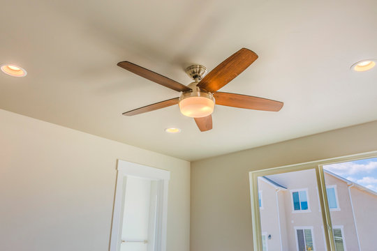 Ceiling fan with wooden five blade design and built in light