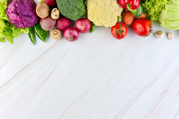 Fresh colorful healthy vegetables on marble countertop background