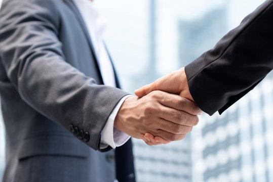 Businessmen making handshake in the city