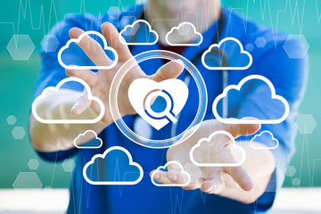 Doctor presses button search for heart disease in cloud network. Medicine and healthcare concept on green background.