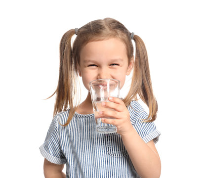 Cute little girl drinking water on white background