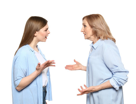 Quarreling mother and daughter on white background
