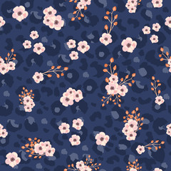 Seamless pattern with leopard skin and pink small flowers. Trendy textile print. Vector hand drawn illustration.