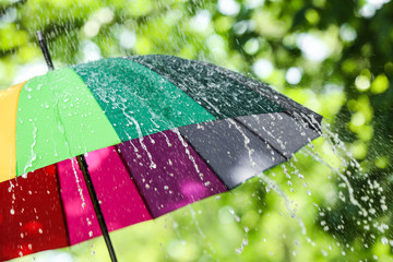 Colorful umbrella outdoors on rainy day
